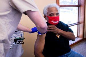 Ernie Chambers getting COVID-19 vaccine