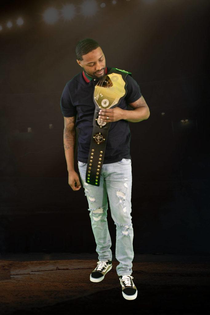 josh-jones-holding-belt-scaled